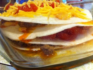 Close up of taco bake layers before going in oven.