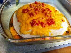 Top view of layered taco bake before going into oven.