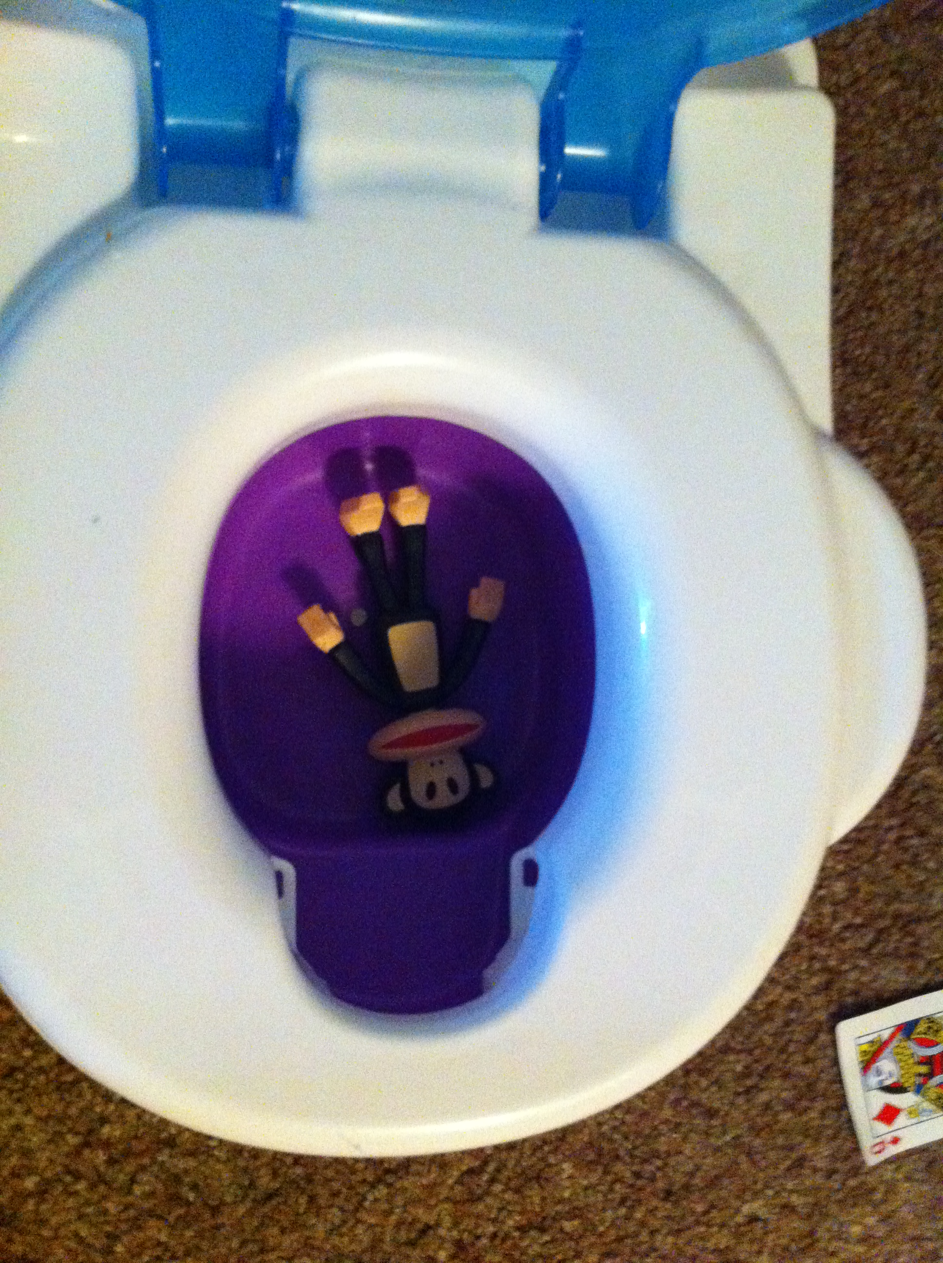 monkey in potty chair