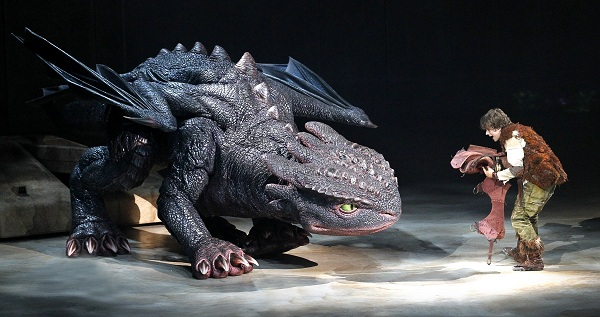 Hiccup (Rarmian Newton) fixes Toothless' tail, photo credit Jeff Busby