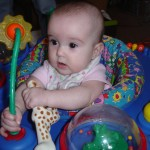 Rissa in the exersaucer we got from Freecycle in April 2011.