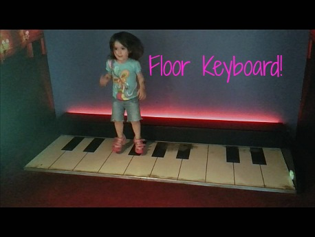 preschool girl on floor piano