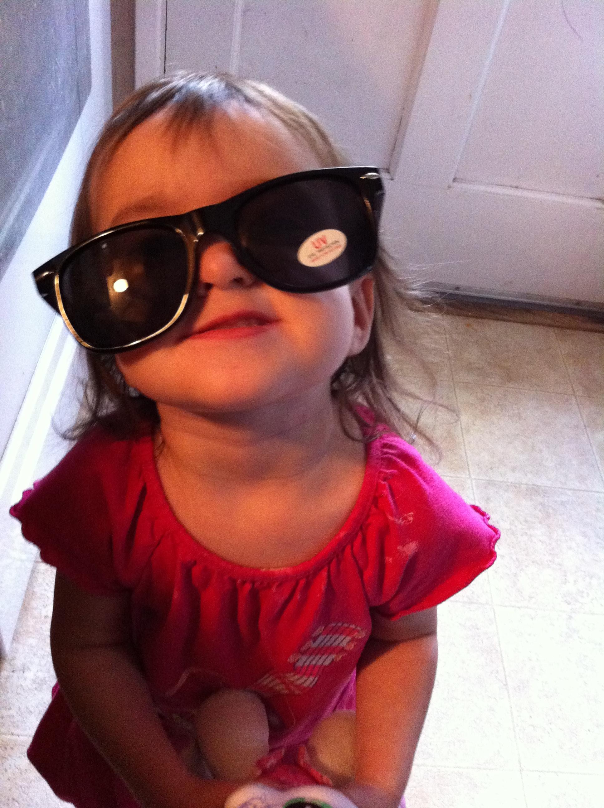 toddler wearing big sunglasses