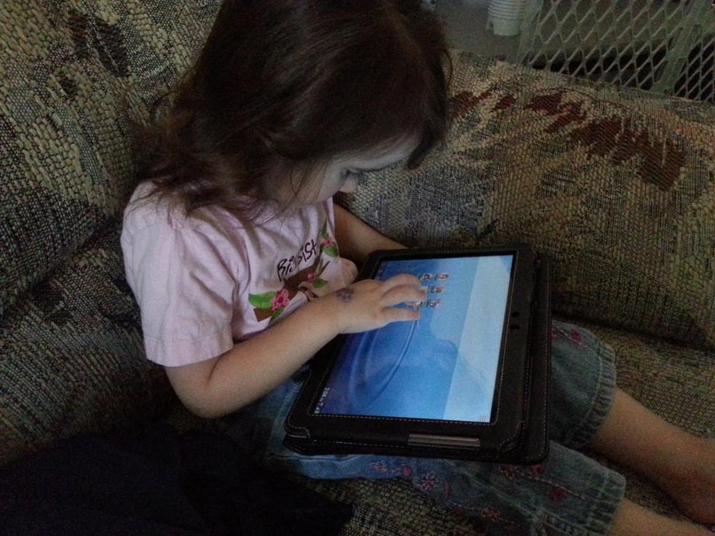 toddler using tablet