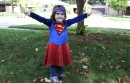 toddler girl wearing supergirl costume