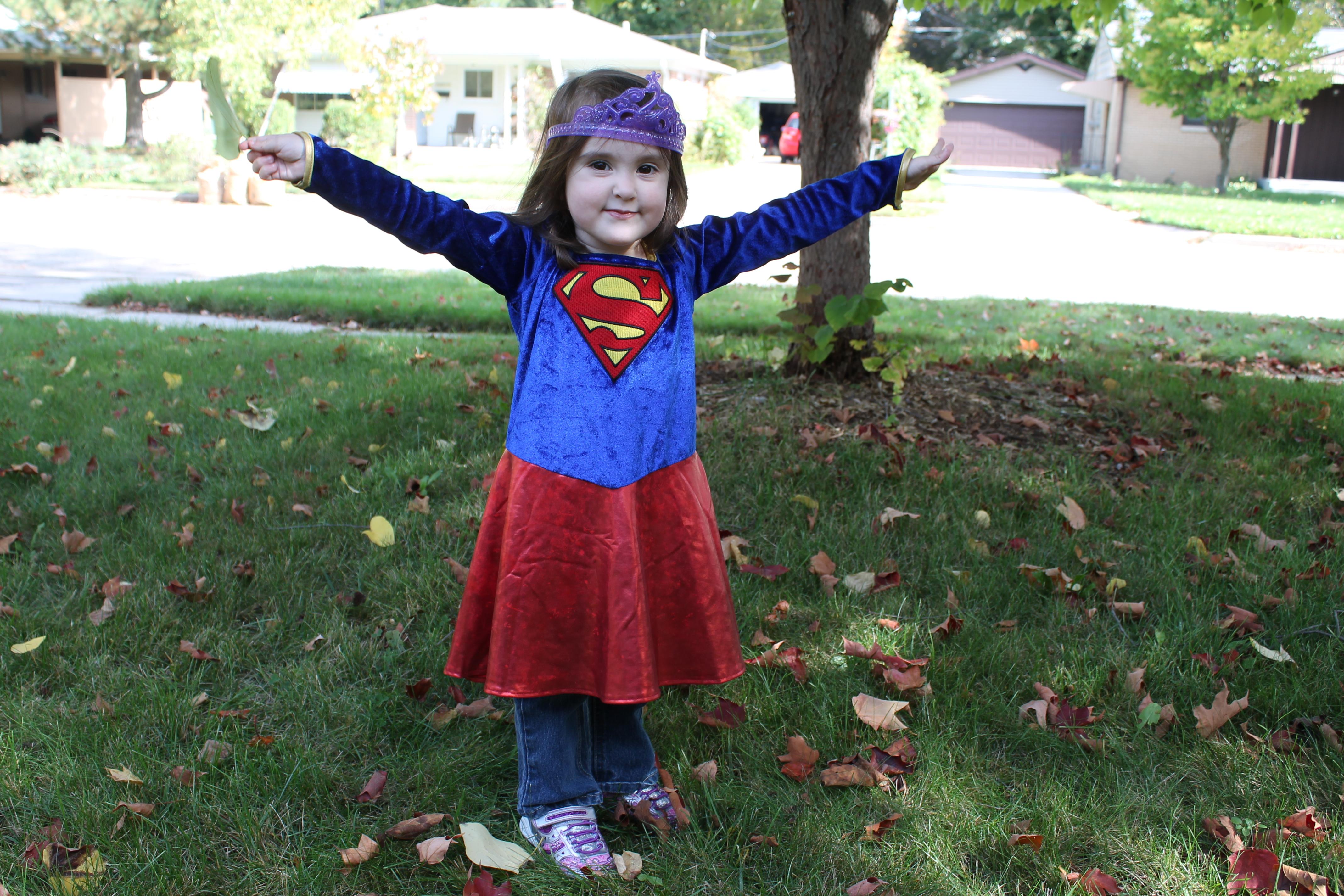 toddler girl wearing supergirl costume