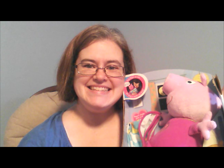 woman holding bedtime peppa doll