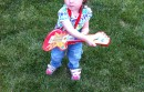 toddler playing toy guitar