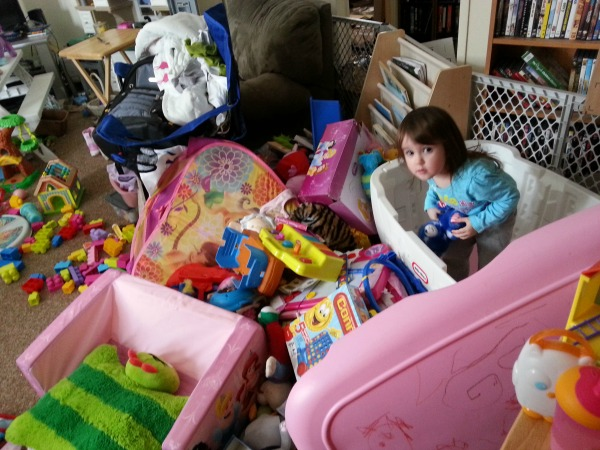 toddler standing in empty toy box in messy room #shop