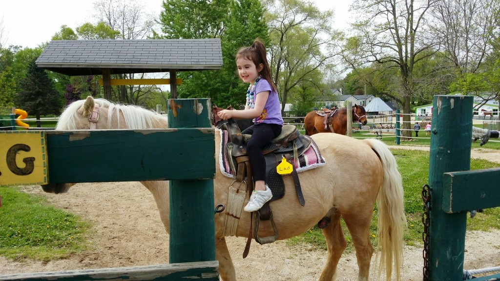 Darcy's daughter on pony ride at Green Meadows Farm