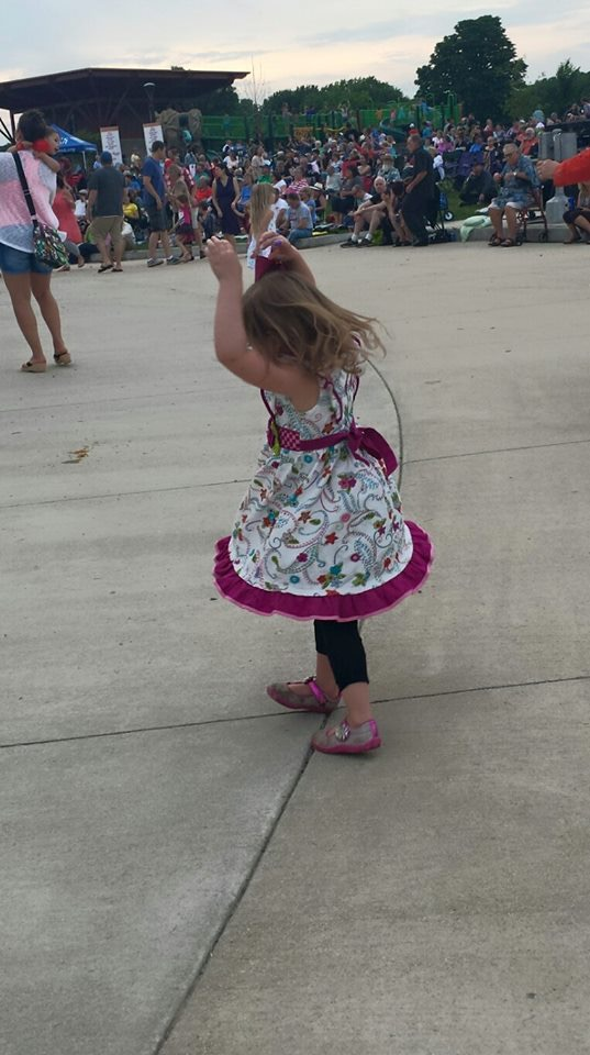 Little girl dancing to live music at Tosa Tonight.