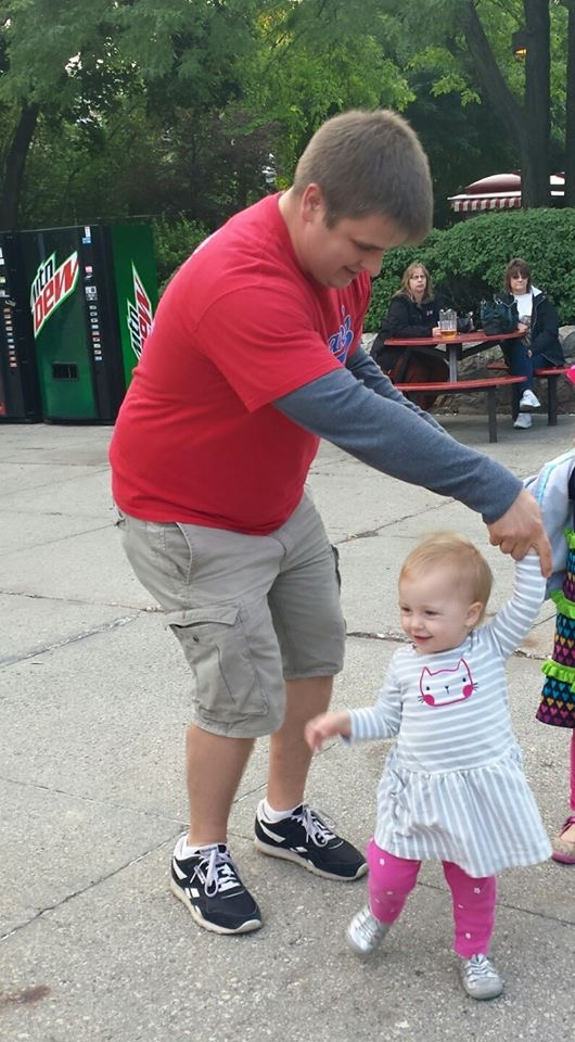 Daddy dancing with toddler daughter at Milwaukee County Zoo Sunset Safari event.