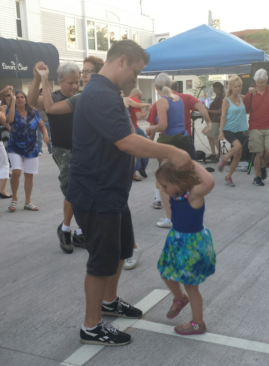 Daddy and daughter dancing in the street at Friday Night Live in Waukesha