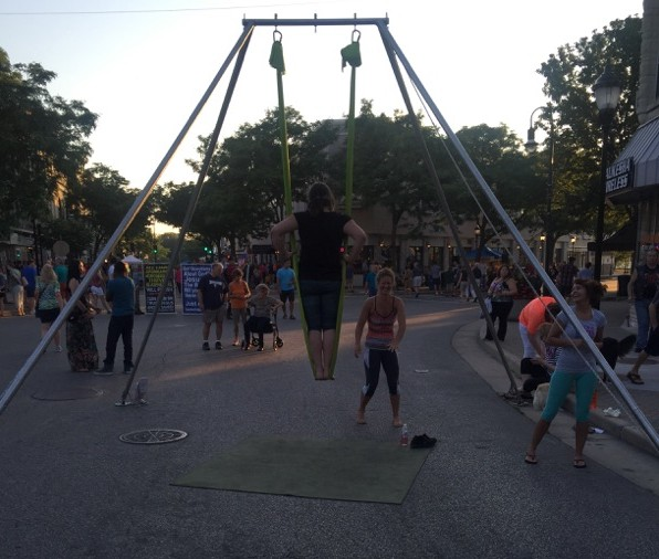 Trapeze yoga at Friday Night Live in Waukesha