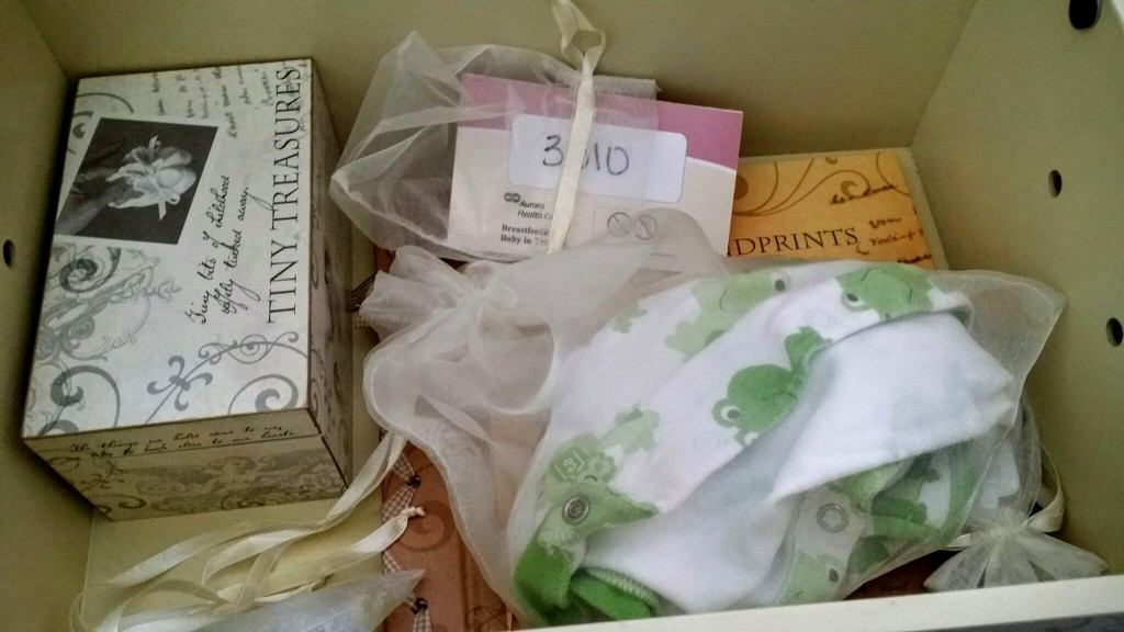 Baby items inside a memory box