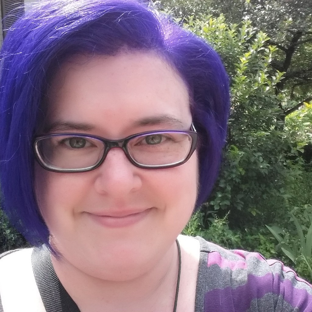 Darcy with purple hair.
