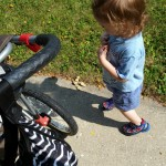 Xander-walking-by-stroller.jpeg