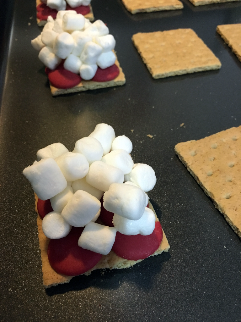 Preparing Christmas S'mores for the oven