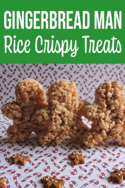 Gingerbread man shaped rice crispy treats standing up on white paper backdrop with little candy canes printed on it.
