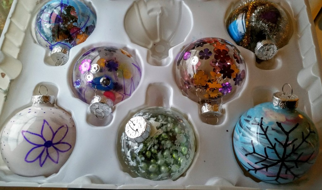 Homemade Christmas ornaments using acrylic paint, sequins, pipe cleaners and more