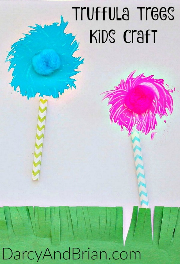 One blue painted truffula tree and one pink with pom pom centers. Each has a chevron striped straw for a trunk.