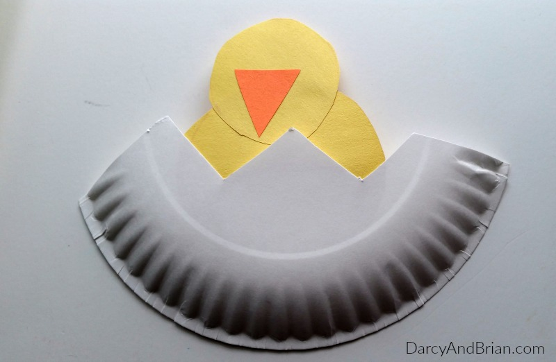 Glue the chicken to the bottom of the paper plate, then decorate!