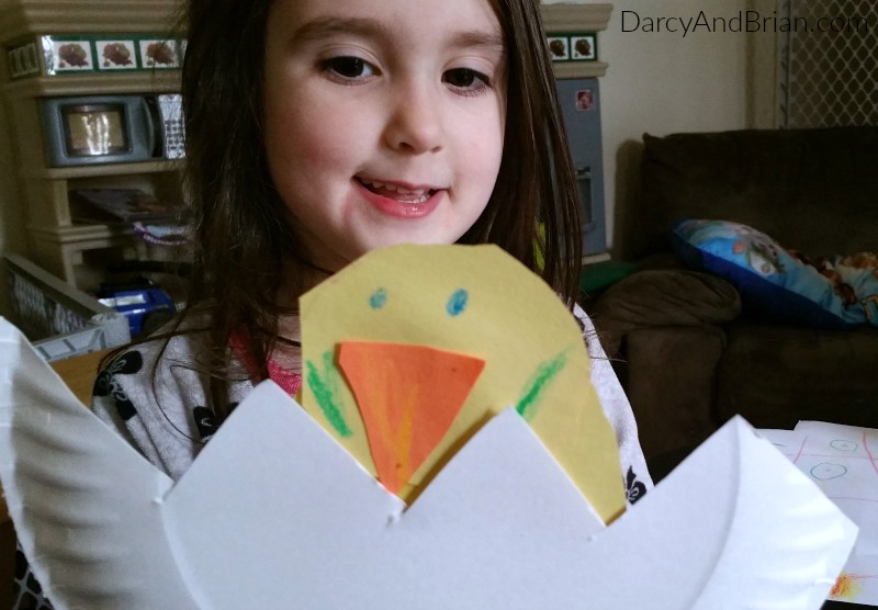 My daughter had fun making her own hatching chicken using paper plates and construction paper.