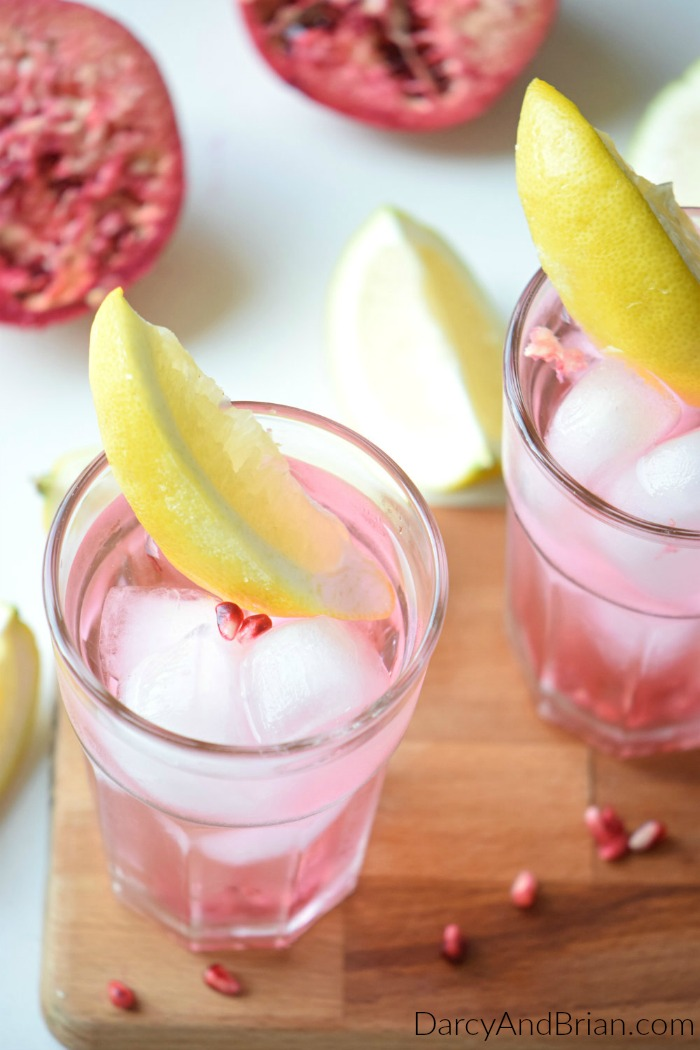 Relax with friends on a hot summer day with this Pomegranate Lemon Mocktail rrecipe. It's easy to turn this into a tropical cocktail for adults only too.