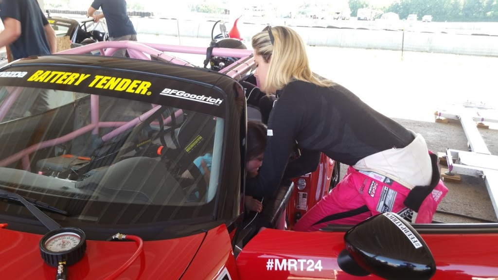 My daughter getting in Ashton Harrison's race car.