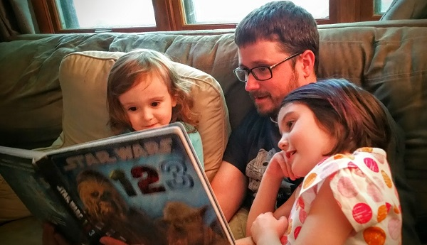 My husband Brian reading Star Wars 123 to our kids.