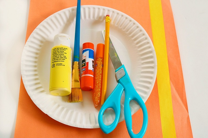 Craft supplies you need to make this preschooler sun craft.
