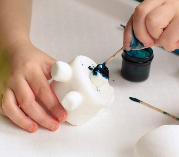 Fun food craft for kids making polar bears out of marshmallows