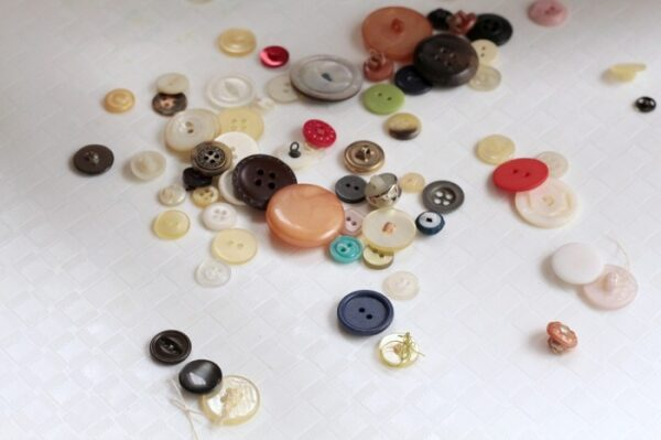 Use buttons for fine motor activities.