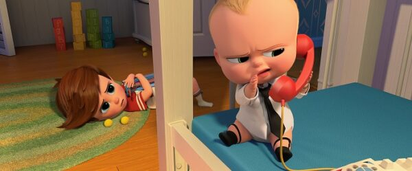 Boss Baby Promotion Image - Older brother Tim catches Boss Baby talking on the phone.