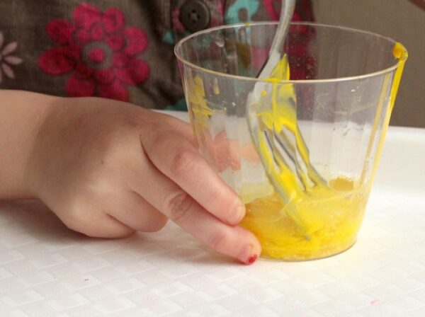 Kids can help mix the playdough during this step.