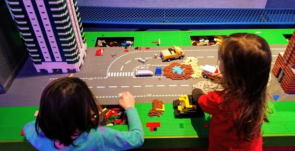 The kids building at one of the tables in LEGOLAND Chicago.