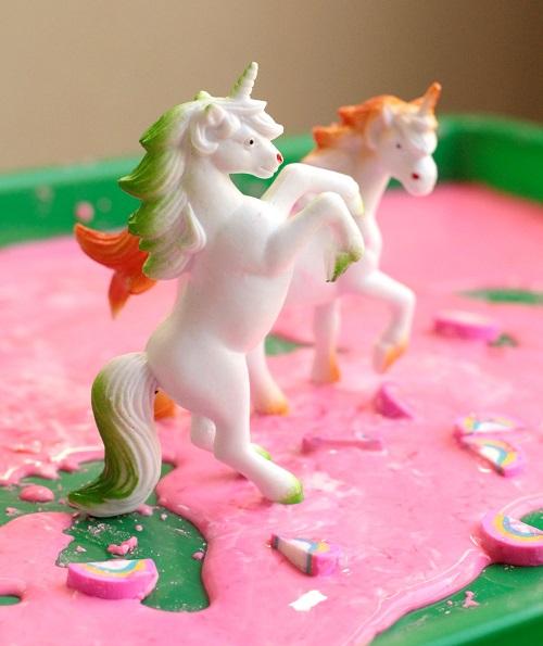Setting up unicorn sensory bin for kids