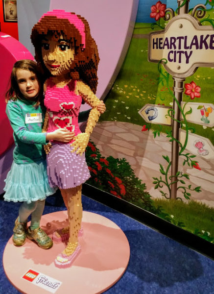 My daughter posing with LEGO Friends model at LEGOLAND