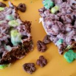 Looking for a fun and easy snack idea? Get the recipe for these Chocolate Lucky Charms Crispy Treats. Cute snack for St. Patrick's Day too.