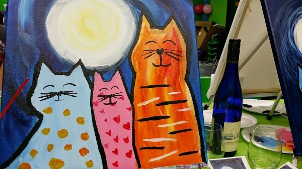 A canvas painting with cats during a wine and paint night activity.