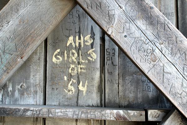 Someone wrote AHS Girls of '54 inside the bridge