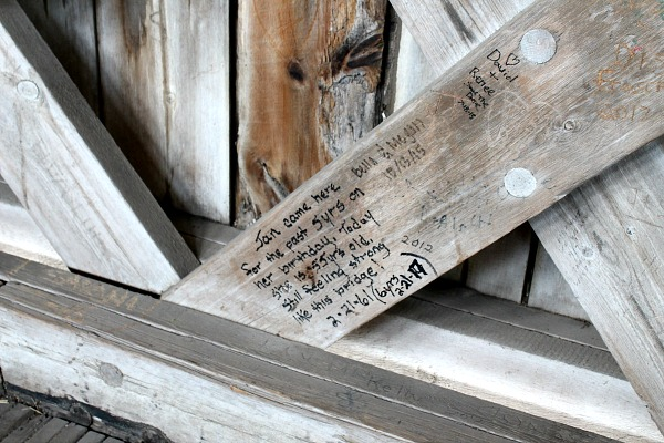 Many people left messages or marks on the wall of the covered bridge.