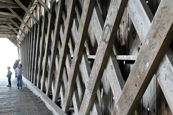 The lattice woodwork inside the covered bridge.