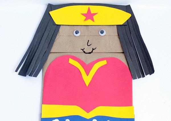 Learn how to make this fun Wonder Woman paper bag craft for kids!