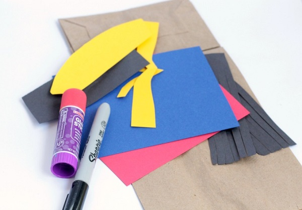 How to make a Wonder Woman inspired paper bag puppet with the kids.