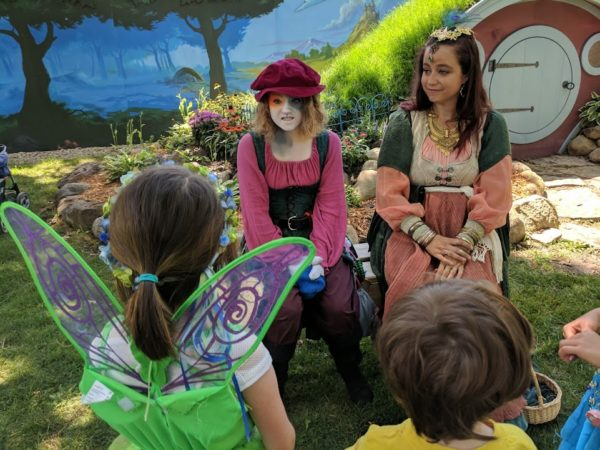 Kids interact with cast members as part of the KidsQuest adventure at RenFaire
