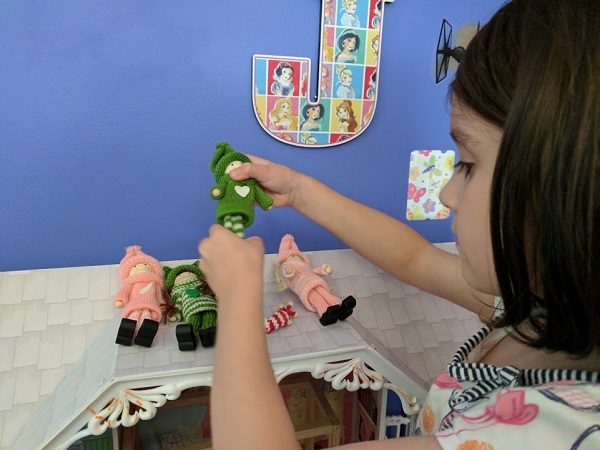 My daughter playing with pink and green Kindness Elves.