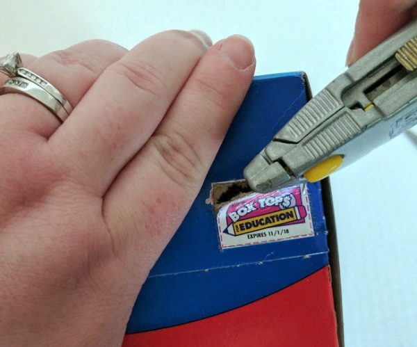 Carefully removing Box Tops with box cutter.