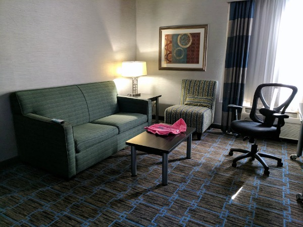 Sitting area in hotel room at Holiday Inn Express Janesville