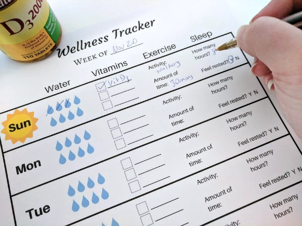 Filling out weekly wellness tracker printable